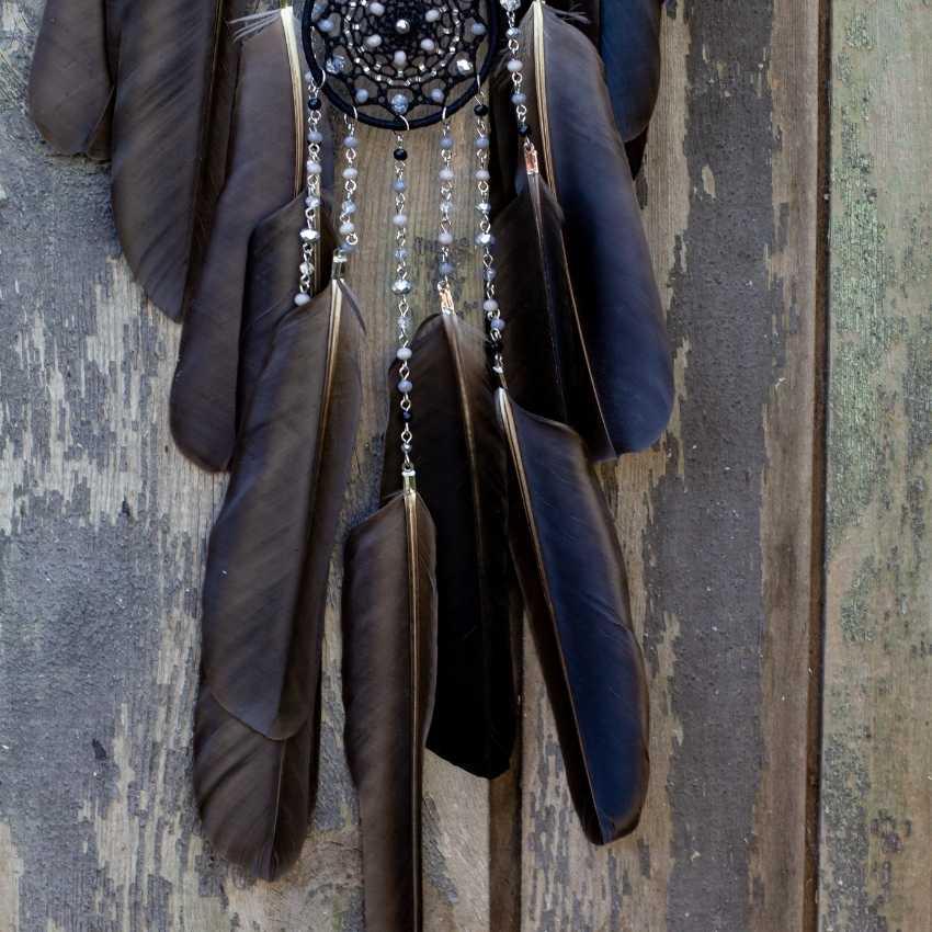 black feather in dreams