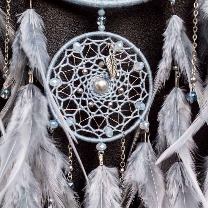 gray feather dream meaning