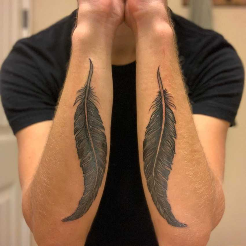 raven feather tattoo meaning